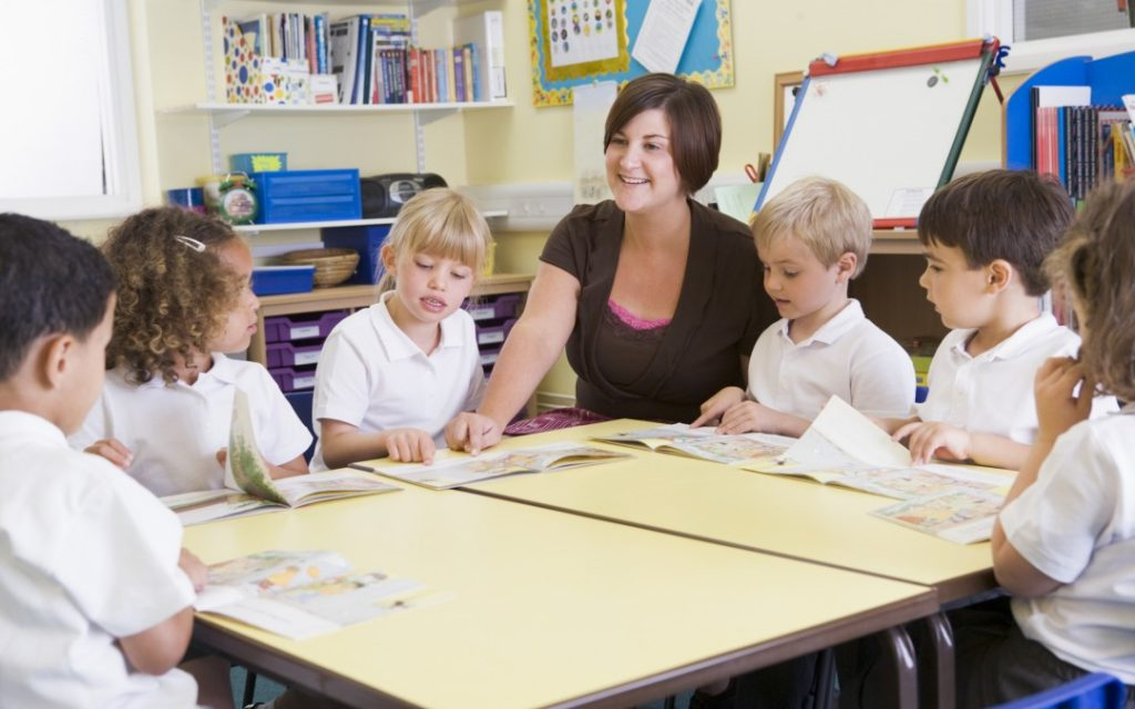 primary-school-teacher-and-children-1080x675.jpg